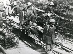 An injured American soldier is carried on a stretcher during action at Boureville, Forest of Argonne, north eastern France during the First World War.