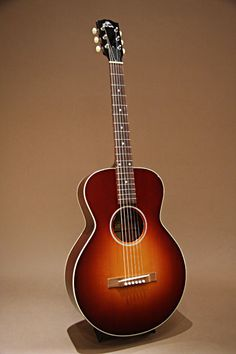 Gibson L-1 20th Anniversary (2009) : Limited run of 20. Made to commemorate the 20 years of Gibson's acoustic guitar production in Bozeman, Montana. Adirondack Red Spruce top, Mahogany back & sides.