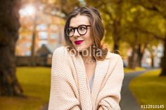Young cute girl smiling in autumn scenery