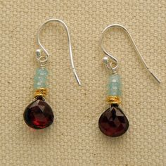 Rosy Garnet and Aquamarine Earrings charm with a beautiful faceted garnet teardrop hanging from a row of aquamarine stones  highlighted with 14kt gold fill beads.