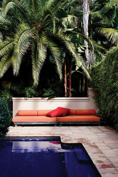 deep indigo tiles make the pool look bottomless + perfectly contrast with the pop of tangerine