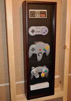 Classic, Super, GameCube, Wii Nintendo controller wall display case - this would be awesome for Ricky's game room Sala Nerd, Deco Gamer, Wall Display Case, Nintendo Controller, Geek Room, Geek Home Decor, Video Game Rooms, Video Games, Video Game Bedroom