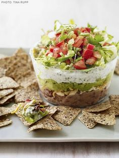 "Vegan Mexican Layer Dip - You coudl use even that black bean dip for the bottom and layer with guac, chopped tomatos, a tofu ""sour cream"" and lettuce."