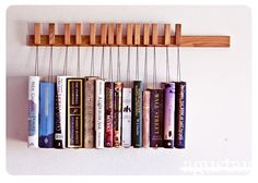 Custom made wooden book rack in Oak. The pins are also bookmarks.. $210.00, via Etsy.