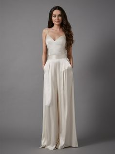 Create your own individual bridal style with our versatile and whimsical bridal separates! From essential and graceful tops to modern yet romantic skirts and trousers, our separates are for the free spirited and unique bride. Bridal Pants, Wedding Jumpsuit, Bridal Dresses, Bridal Pant Suits, Belle Bridal, Bridal Style, Catherine Deane Bridal, Wedding Bodysuit, Wedding Pantsuit