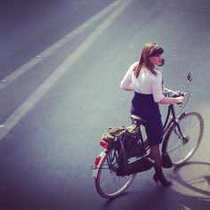 How impossibly amazing is this Parisien Woman riding a bike in a pencil skirt and stilettos? (iPhone photo taken at random by a friend in Paris)