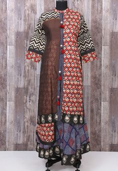 Beautiful printed cotton and Chanderi mix kurti with brilliant play with prints placement and with beautiful detailing.