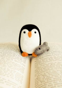 needle felted penguin (with fish) from handmadebybrynne on etsy. Use as inspiration to make own version.