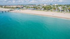 7 Relaxed Florida Beach Towns Perfect For A Low-Key Weekend At The Beach — Tripadvisor Sarasota Florida, Old Florida, Florida Travel, Florida Beaches, Beach Travel, Canary Island Date Palm, Clearwater Florida, Best Flights, Sanibel Island