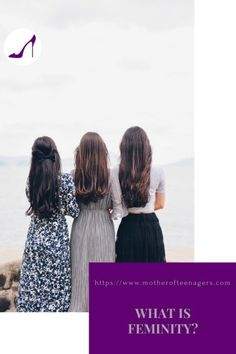 A rear view of three young women with long dark hair looking out across the sea.