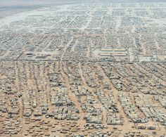 """[8/28/15] A Syrian refugee camp in Jordan, which has a population of around 6 million people. Now 1.5 million Syrians call Jordan home. """"Native Jordanians will tell you how difficult things are – but you won't hear any protests from them about the refugees, although only around a fifth live in refugee camps, while the rest are accommodated in Jordanian towns and villages."""" Learn more about Jordan on our library's website here http://sherloc.imcpl.org/?itemid=