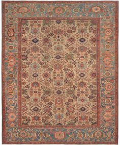 Sultanabad, 11ft 7in x 14ft 4in, 3rd Quarter, 19th Century. Possessing a highly coveted, atypical palette of pastel and tropical hues, this exceptional large Persian room-size carpet offers original and captivating artistry, achieved through expert dyeing and a sense of perfect proportion and color placement. This unusually wide antique carpet's prized ivory field is graciously complimented by an expansive, constantly striated azure border.
