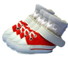 Red Dog Sneakers from SimplyDogStuff.com are super cute sneakers made of sturdy construction which are perfect for play, protection, and fashion.  The canvas body is soft and  breathable, together with the non-slip sole, these sneakers are stylish and will protect your pup's paws from the elements.