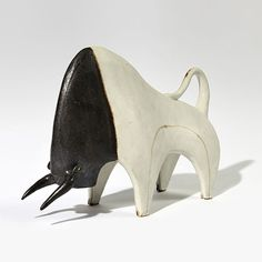 """ITALIE  ca 1970 BRUNO GAMBONE « Toro » a sculpture made of white, beige and black earthenware signed """"GAMBONE - ITALY"""" at the back measurements : height : 9.5"""" (24 cm) - length : 14"""" (36 cm width : 4"""" (10 cm)"""