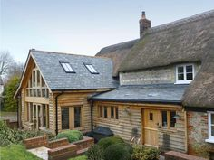 This heritage house extension was designed to emphasise its own contemporary significance and to allow for more usable living and utility spaces for the occupants Building Extension, House Extension Design, Extension Ideas, Roof Extension, House With Porch, House In The Woods, House Front, Garden Room Extensions, House Extensions