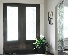 """DIY """"L-O-V-E"""" art by Honey We're Home.  Such a great idea for a front door entry."""