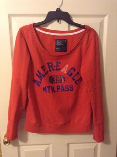 Adorable, vintage, American Eagle sweatshirt. Designer faded. Maroon and dark blue letters. || size M || || $12 ||