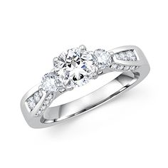 This gorgeous engagement ring features 1 CT round diamond crafted in 14K white gold.