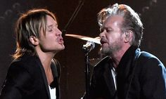John Mellencamp, 64, was joined by Keith Urban, 48, on Wednesday for a spirited duet during the CMA Awards in Tennessee.