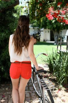flowy tops, colorful shorts, bicycle, wavy hair, sun, flowers. looks like a perfect day to me!
