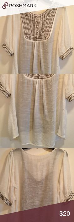 """White Crinkle-Gauze Tunic top Beautiful silky crinkle-Gauze type Tunic blouse with silvery grey embroidered bodice. At 28"""" long this Tunic is meant to be loose and flowing. 21"""" wide across waist and 15 1/2 across shoulders. Comes with a charcoal colored slinky camisole   There are no tags. When purchased this top was advertised as 'one size' I believe the material is polyester but cannot say for sure. Any questions just ask ✌🏼 Tops Tunics"""