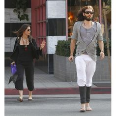 Russell Brand and a lady friend went shopping in West Hollywood on Sunday.