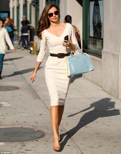 Looking her best: Super stylish Miranda Kerr is all smiles as she walks in New York on Monday