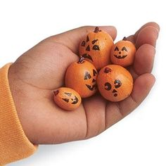 How to make it:  Remove the caps from a handful of acorns,    Coat each one with orange acrylic paint adding a bit of brown to the acorn's point for a stem,   Let the paints dry,  add a jack-o'-lantern face with a black permanent marker.
