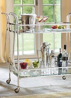 Easily host a five-star quality cocktail hour with the help of the sophisticated Cosmopolitan Bar Cart; a functional statement piece that will quickly become an entertaining essential.