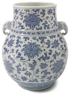 A large blue and white 'lotus' vase with elephant handles China, 19th/20th century, heavily potted, the rounded body rising from the short foot to a waisted neck with lipped rim, flanked by a pair of elephant handles, the exterior painted in cobalt-blue with stylized lotus blossoms, with fitted wood stand, height 19 1/4 in. | Sotheby's