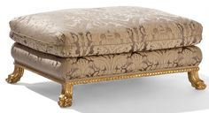Cavello II Footed Ottoman from Collection Ten by @ebanistacollect. Antiqued 22k gold finish. Upholstered in Ebanista's La Fleur Silver silk with Grois Grain Silver flat tape and Lauren Stell decorative cord. Discover more at www.ebanista.com