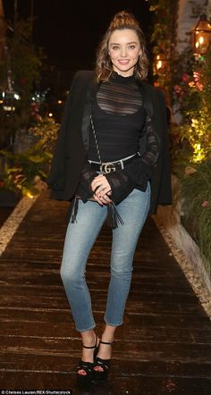 Denim dream: Miranda Kerr,33, showed off a pair of her new jeans at the launch of her new denim collection at Catch LA in Los Angeles on Wednesday night