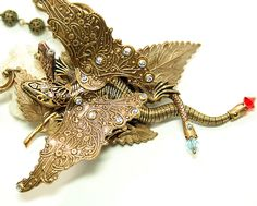 Art Nouveau Necklace Dragon Necklace Victorian Steampunk Necklace Snake Statement Jewelry. $124.99, via Etsy.