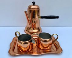 Excited to share this item from my #etsy shop: Vintage, Coppercraft Taunton, Chocolate Pot/ Coffee/ Tea Set, 4 Piece Set Includes Chocolate Pot, Tray Creamer and Sugar / Vintage Copper #copper #brown #metal #coppercraftguild #vintagecopperset #copperchocolatepot #coppercreamersugar #coppertray #copperteapot Copper Tray, Small Tray, Pot Sets, Pink Depression Glass, Chocolate Pots, Brass Handles, Glass Collection, Vintage Colors, Tea Set