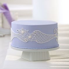 Petite flowers and lovely lace-like lattice piping give this cake a professional-looking flair! Learn these simple line piping techniques by taking a Wilton Method Class on Craftsy. You'll be amazed by your handcrafted creations.
