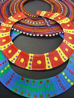 Paper plate african necklaces- or Egyptian. This is one of those ideas where you think to yourself of course that's so simple it beats cutting out 100 card circles why did I not think of this.