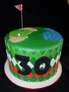 This cake was made for a golfer's 30th Birthday. The sides of the cake have diamond shaped designs in the colors of the Irish Flag to represent his Irish heritage.