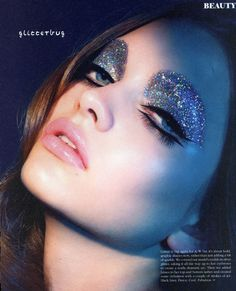 Katiusha Feofanova by Cameron James Wilson. Add tons of glitter to your eyes in striking bold and graphic shapes. Love the 60's air to this makeup look.