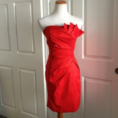 Red Beauty Party Dress Juniors Medium Strapless dress with side folds and beautiful bodice fanning. 61% Polyester, 24% Nylon & 15% Spandex, fabric is a rich red with stretch.  Laying flat hips 16inch, waist 13 inch, bust 16 inch , 26 inches from under arm to hem. Lenovia Dresses