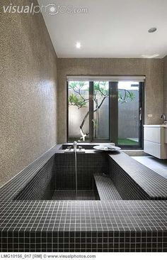 Large mosaic tile bathtub with running water #home #decor