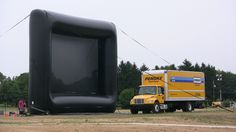 Where do you hide a 24' rental truck? Behind our 46'x33' screen of course.