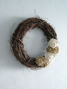 wreath w/burlap flowers... probably a good use for the plain wreaths and box of burlap i just inherited from Nana's