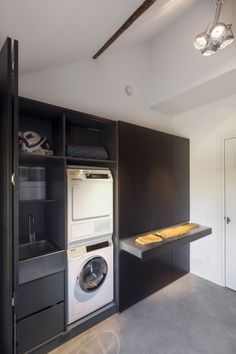 Modern laundry room with black cabinetry and black tapware
