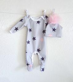 organic baby footie in navy, blush star print on light grey