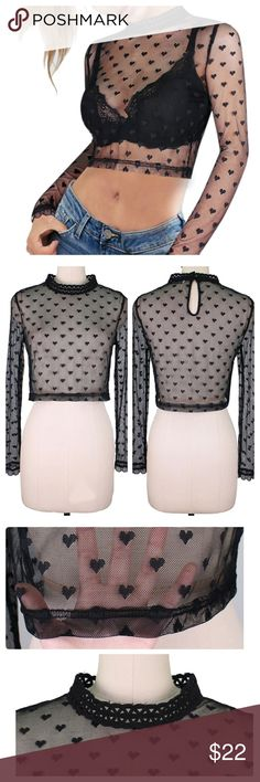JUST IN: Mesh Heart Crochet Crop Top Material: mesh polyester with heart pattern. Long sleeved. Cropped top. Keyhole design at  back closure. Pretty crochet design on neck. Can be worn underneath a dress or over a sexy bralette.   Fabric has stretch to it. Please refer to size chart before purchasing.  Hand wash cold, air dry. Tops Crop Tops