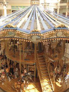 two story.We have a double decker French Carousel in the Mall near us, it is two stories of horses and swan chairs and spinners. Carosel Horse, Fair Rides, Tableaux Vivants, Amusement Park Rides, Carnival Rides, Wooden Horse, Painted Pony, Merry Go Round, Creatures