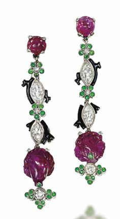 A PAIR OF ART DECO RUBY, DEMANTOID GARNET AND DIAMOND EAR PENDANTS  Designed as a fruiting bough, each single ruby cabochon top to a demantoid garnet flowerhead and marquise-cut diamond line, flanked by black enamel branch motifs, suspending a single carved ruby foliate drop with diamond and demantoid garnet terminal, circa 1920