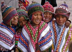 The people of Latin America are as diverse as the countries that make up this colourful region.  These Peruvian school boys wearing traditional colorful ponchos and chullos (hat with earflaps) sum up the spirit of the people that you will meet on your travels.