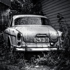 An old Volvo Amazon parked between two houses in the old part of Oslo
