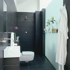Dark tiles behind white basin.